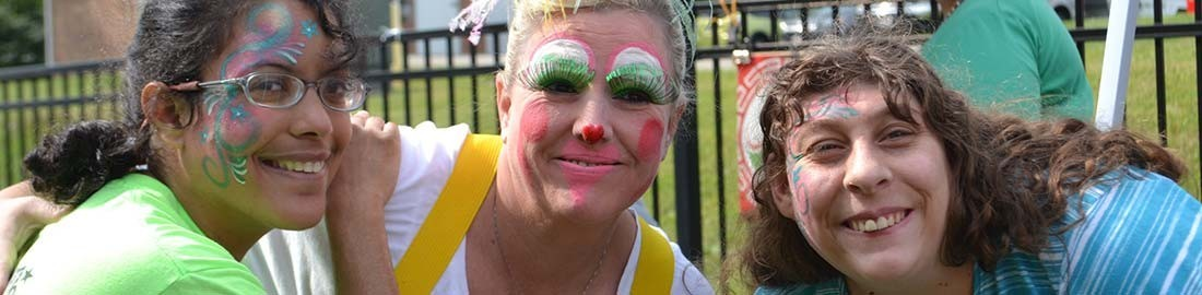 WCBDD enrolled individuals are seen here showing off their face paintings at an event.