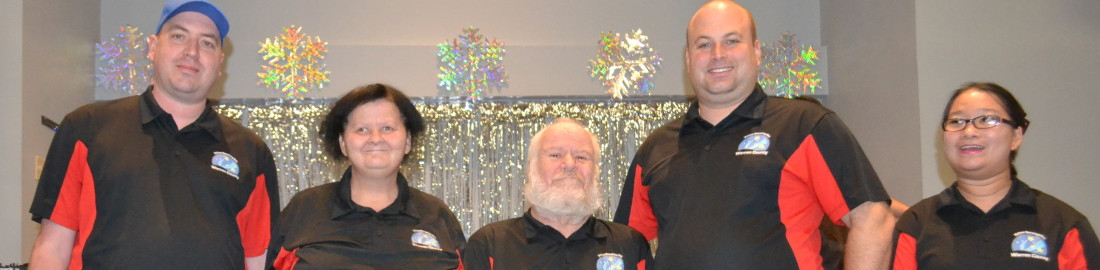 Five members of the Self Advocacy - Voices Speaking Out group are shown here at a holiday event